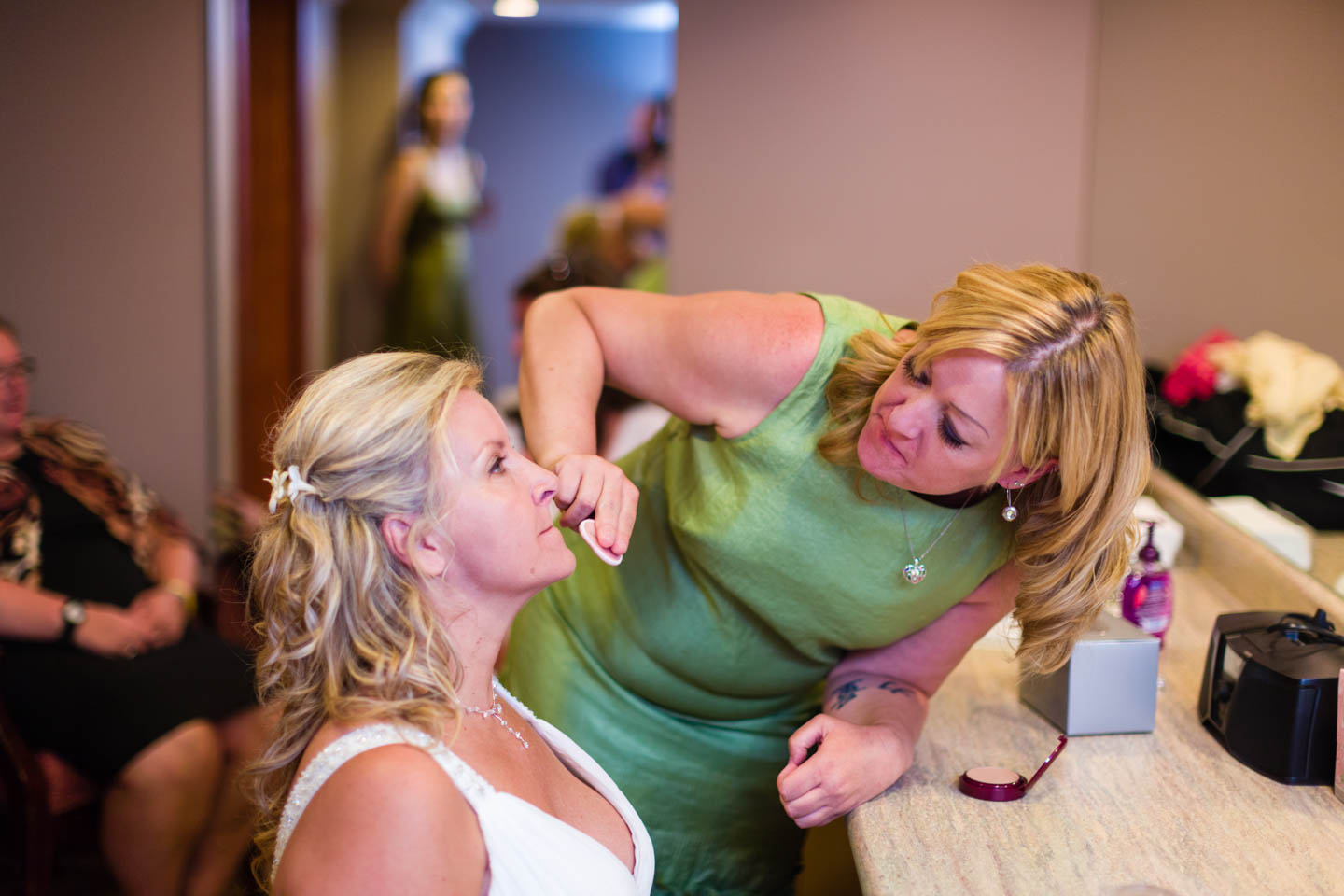 Bride gets makeup ready for wedding