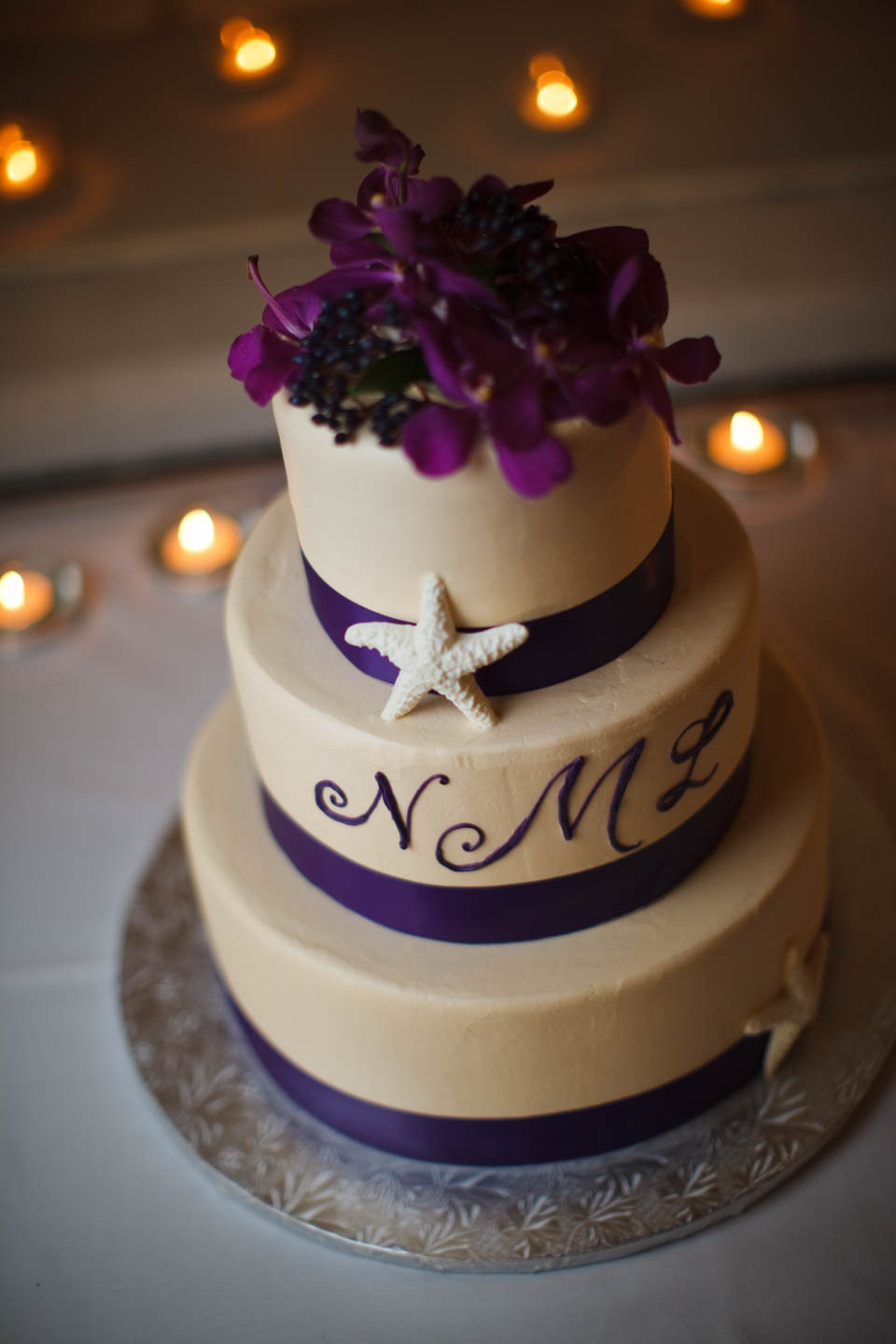 Wedding cake with purple and tan color scheme