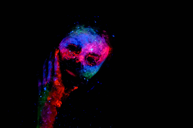 Model painted in blacklight that looks like a stellar nebula