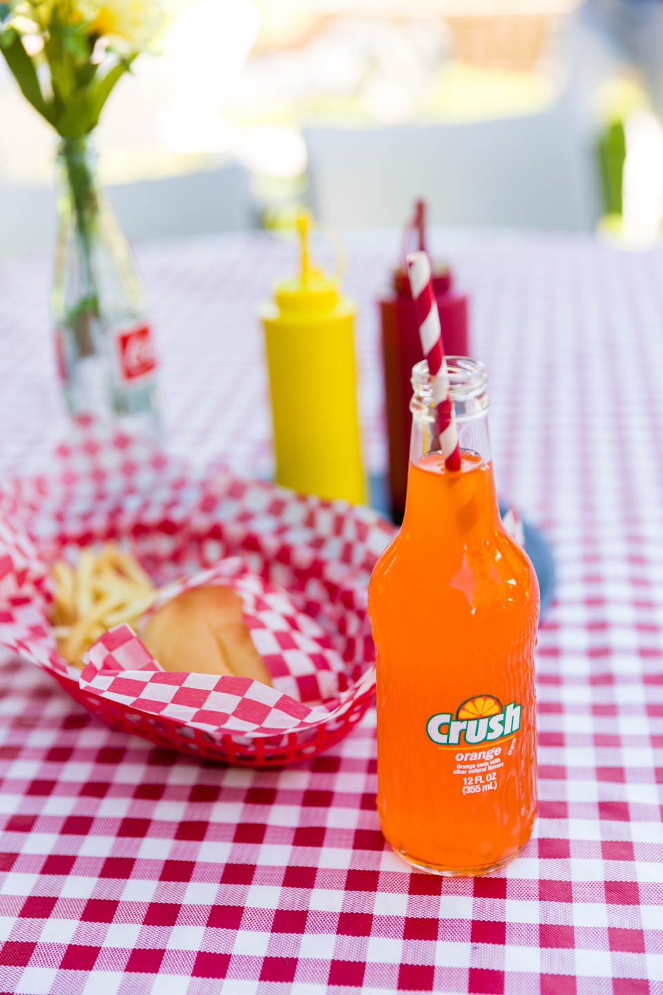 50s themed diner menu with hamburger and fries and bottled soda